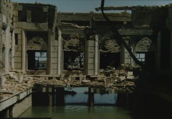 A bombed out palace over the water.