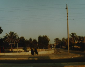 Two Iraqi women walking in the Green Zone.