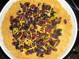 If adding festive ingredients to your cheesecake, a layer directly on the crust is a must!  I added dried cranberries and cherries as well as lemon zest.