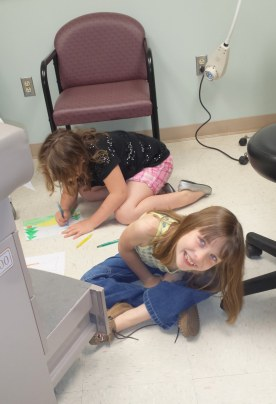 The girls goofing around in the exam room during another visit to see my physician about my headaches and illness.