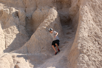 My son scrambling down the natural stairs cut over time on a Badlands formation.