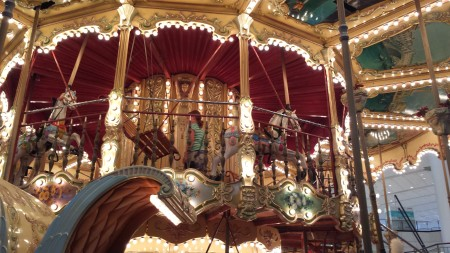 Choosing the perfect steed for a carousel ride.