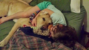 Ross taking a nap with his person, Alexis, this spring.