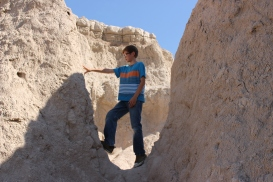 My son enjoying a quick climb on the Badlands this summer.